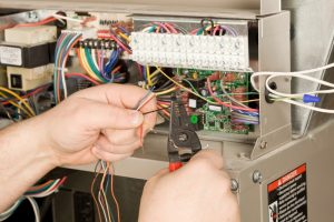 HVAC-installer-strips-small-wiring